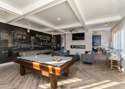 View our photo gallery image of apartment community clubhouse with pool table